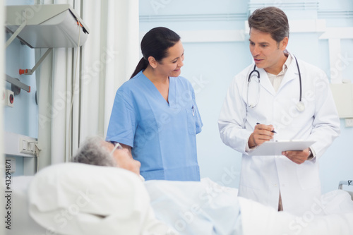 Doctor and nurse talking to a patient