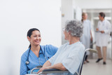 Nurse looking at a patient in a wheelchair