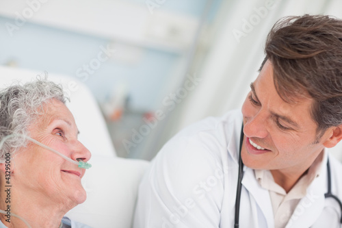 Close up of a doctor looking at a patient