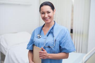 Nurse holding a medical folder