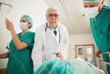 Doctor and surgeon looking at a patient