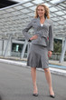 Businesswoman standing with hand on hip