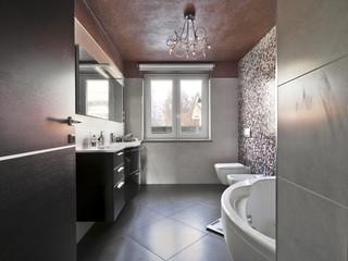 bagno moderno con vasca e mobile per il lavabo