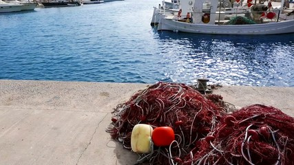 Balearic islands formentera port with trammel fisher nets buoys