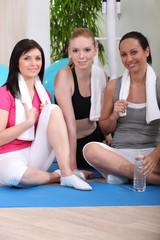 three women resting after fitness