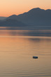 Lonely boat in the sea on sunrise