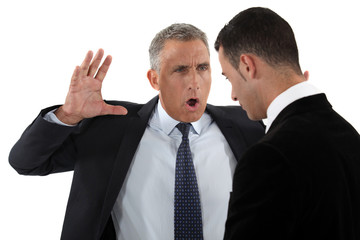 Boss shouting at employee
