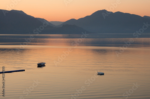 boats in the sea on sunrise