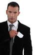 businessman sticking out business card