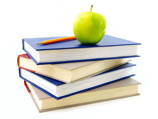 Stack of textbooks with apple and pencil on top