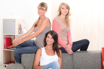 three women relaxing in a lounge