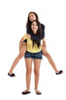 Sisters riding piggyback