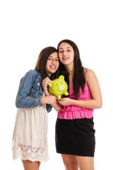 Teen girls with piggy bank