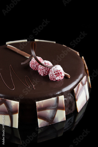Sacher cake decorated with raspberries