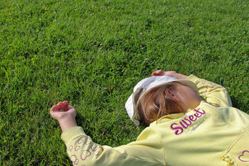 Sweety sleeping girl on the grass