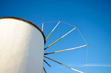 Old windmill against blue sky in Greece