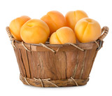 Raw apricots in a basket
