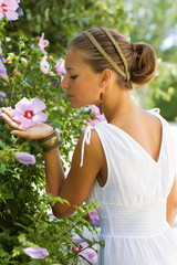 Greek styled girl smelling the flowers