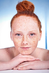 Portrait of an attractive freckled girl