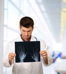 Doctor Studying Hand X-ray