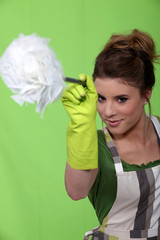 Woman in green with a feather duster