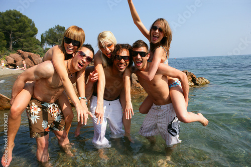 young people having fun at beach