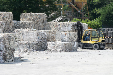 fork lift and paper bales
