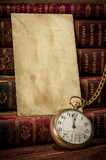 Old photo paper texture, pocket watch and books in Low-key