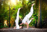 Yoga couple in the garden