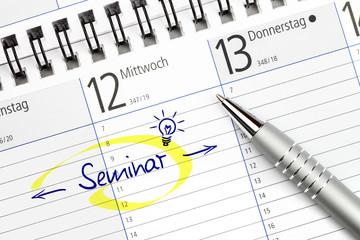 Terminkalender mit Eintrag für ein Seminar