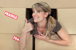 Positive woman with packing boxes