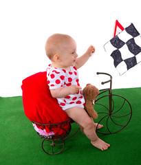 bébé qui fait du vélo