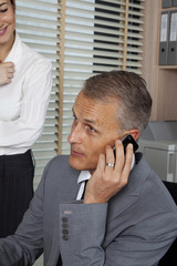 handsome businessman talking by telephone
