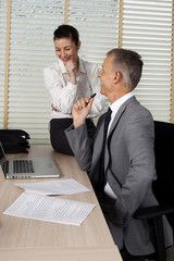 secretary talks with the employer