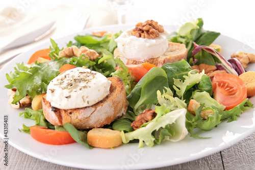 salad with walnut, bread and goat cheese