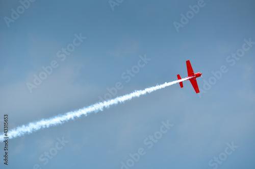 stunt plane trailing smoke