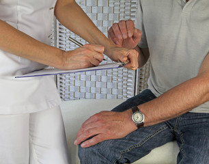 Therapist taking patient's medical history