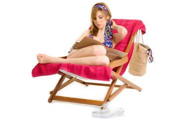 Young woman relaxing on beach chair
