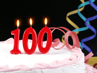 Birthday cake with red candles showing Nr. 100
