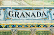 Granada sign over a mosaic wall