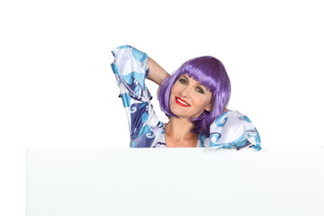 Woman in a purple wig with a blank board ready for your message