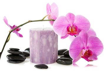 orchid,aromatic candle and black stones