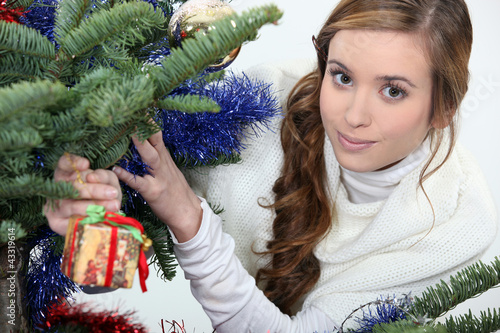 Young woman under a Christmas tree