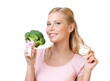 Beautiful woman holding broccoli, isolated