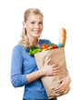 Pretty woman with a paper bag full of healthy eating