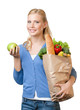 Young woman with a paper bag full of healthy eating