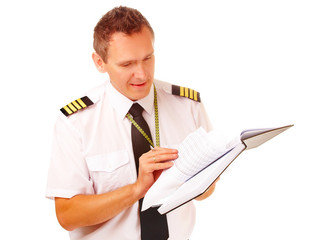 Airline pilot filling in papers