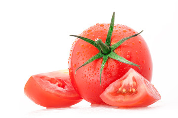 Tomato with water drops, isolated on white background