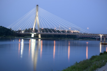 Modern bridge over Vistula River at night. Warsaw, Poland