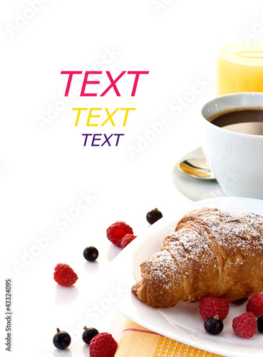 croissant, a cup of coffee, orange juice and fruit for breakfast
